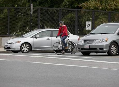 Bicyclist Will Morgan, of Somerville,  waited for the light to turn green.