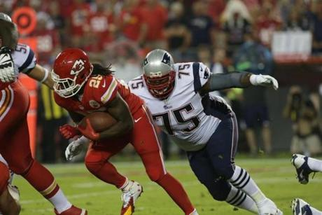 Vince Wilfork tries to tackle Jamaal Charles in the first quarter. (Barry Chin/Globe Staff)