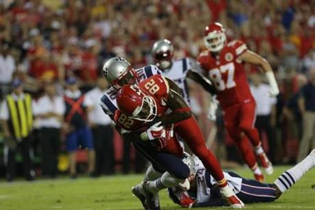 Patriots defensive back Duron Harmon tackled Kansas City's Dwayne Bowe in the first quarter. (Barry Chin/Globe Staff)
