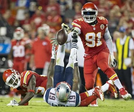 Brandon LaFell lost control of this reception as Kansas City's Husain Abdullah (left) caused the incomplete pass. (Matthew J. Lee/Globe staff)
