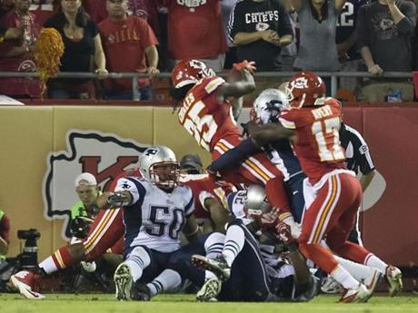 Jamaal Charles jumped over the pile to score a touchdown in the second quarter. (Matthew J. Lee/Globe staff)