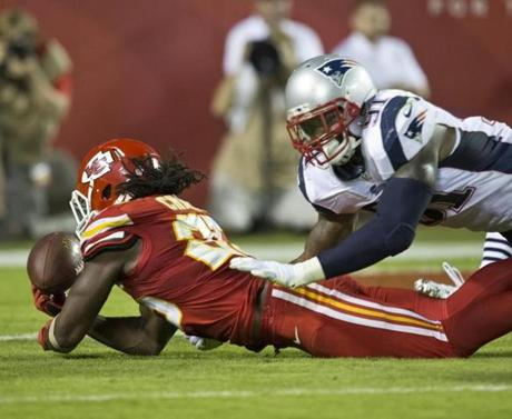 Jamaal Charles fumbled in front of Jamie Collins during the fourth quarter. (Matthew J. Lee/Globe staff)
