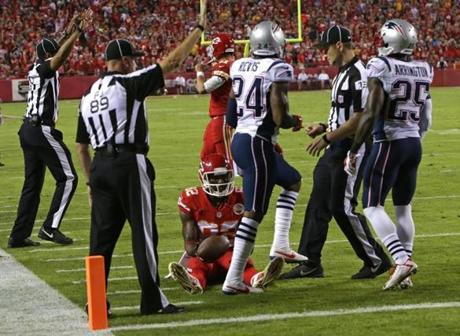 Patriots cornerback Darrelle Revis brought down Kansas City Chiefs wide receiver Dwayne Bowe just short of the goal line, forcing the Chiefs to kick a field goal late in the second quarter. (Barry Chin/Globe Staff)