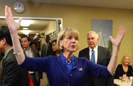 Martha Coakley in Quincy, with her husband Thomas F. O'Connor Jr. not far behind her.