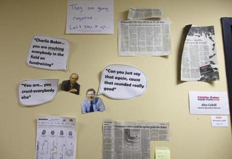 09:54 am - 10/26/14 - Brighton, MA - PHOTO ESSAY - Newspaper cutouts and hand-made cartoons adorn a wall of the Baker campaign headquarters. Charlie Baker met with his campaign staff at his campaign headquarters in Brighton, MA on October 26, 2014. One day on the campaign trail with Republican candidate for Massachusetts Governor, Charlie Baker. Item: photo essays. Dina Rudick/Globe Staff.