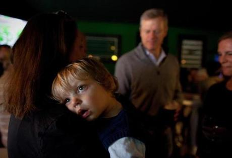 1:46 pm - 10/26/14 - Dorchester, MA - PHOTO ESSAY - The Banshee Pub - Two-year-old Charlie Spicer, cq, of Boston, badly wanted a nap during a Charlie Baker campaign event at The Banshee Pub in Dorchester, MA on October 26, 2014. One day on the campaign trail with Republican candidate for Massachusetts Governor, Charlie Baker. Item: photo essays. Dina Rudick/Globe Staff.