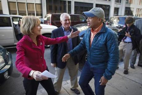 11:07 am - 10/25/14 - Boston, MA - PHOTO ESSAY - State Attorney General and Democratic candidate for Governor Martha Coakley greeted Massachusetts Governor Deval Patrick before they attended a house party political event on Saturday October 25, 2014. One day on the campaign trail with Democratic candidate for Massachusetts Governor, State Attorney General Martha Coakley. Item: photo essays. Dina Rudick/Globe Staff.