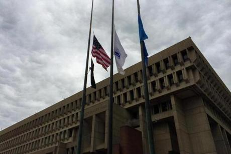 Flags were lowered to half-staff outside City Hall.