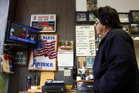 Al Farina watched as news of Thomas M. Menino's death played on a television inside of Logan Square Barber Shop in Hyde Park.