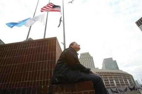 Boston, Ma., 10/30/14, Mayor Thomas M. Menino passes away and City Hall reacts. Janet Rago, a homeless veteran living in the veterans shelter across from City Hall, came to sit on the plaza and pay her respects. Suzanne Kreiter/Globe staff (The Boston Globe.