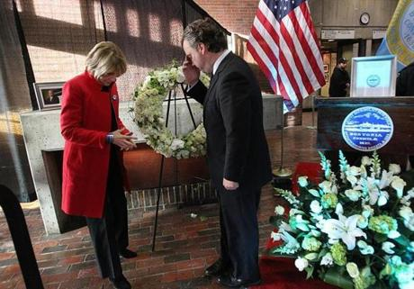 Boston, Ma., 10/30/14, Mayor Thomas M. Menino passes away and City Hall reacts. Gubernatorial candidate Martha Coakley and Lt Governor candidate Steve Kerrigan brought a wreath to City Hall and said a prayer. Suzanne Kreiter/Globe staff (The Boston Globe.