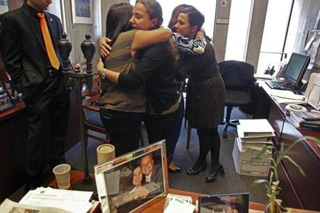 Boston, Ma., 10/30/14, Mayor Thomas M. Menino passes away and City Hall reacts. Employees inside City Councior Sal Lamattina's office, left to right, Michael Sinatra, Nicole Leo, Liana LaMattina who was Mayor Menino's aide at Boston University, Kathy Carangelo, Corinne Walsh. Suzanne Kreiter/Globe staff (The Boston Globe.