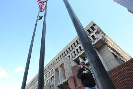 Boston, Ma., 10/30/14, Mayor Thomas M. Menino passes away and City Hall reacts. Tom Kelly, cq, raises the City of Boston flag outside City Hall as a tribute to the late mayor. Suzanne Kreiter/Globe staff (The Boston Globe.
