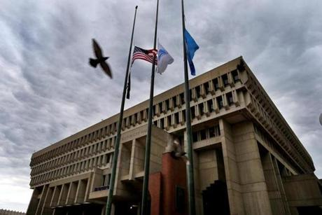 Boston10/30/2014- A cloudy sky hangs over Boston City Hall with flags at half mast after former Boston Mayor Thomas Menino passed away Thursday morning. Boston Globe staff photo by John Tlumacki(metro)