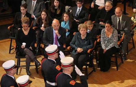 Menino's wife, Angela, two children, and six grandchildren watched as the wake began.