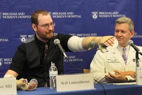 Will Lautzenheiser showed off some of his arm mobility during press conference.