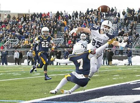 Xaverian's Ernist Simon is called for pass interference as St. John's Prep Jake Burt tries to make a catch.