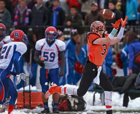 On Newton North's first possesion of the game, senior wide reciever Mike Barbieri (3) got behind Brookline defender Samuel Feingold-Gardner (21) and hauled in a 56-yard touchdown pass.