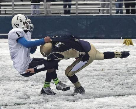 Malden High quarterback Andrew Papa (14) is sacked deep in the backfield by a Medford safety.