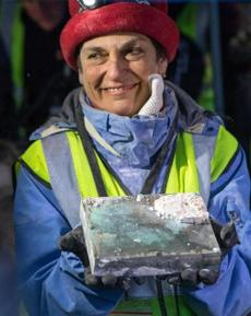 After hours of work, Pam Hatchfield, a conservator at the Museum of Fine Arts, dislodged a time capsule from the cornerstone of the State House.