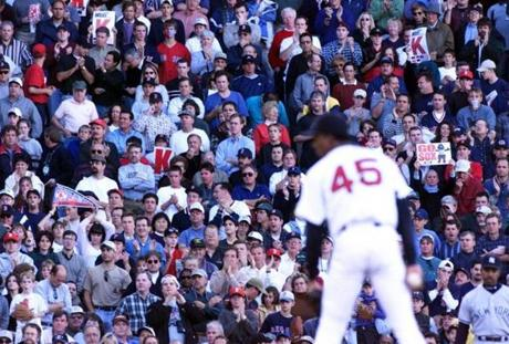 Pedro Martinez is the center of attention in the first inning of Game 3 of the 1999 ALCS at Fenway Park.