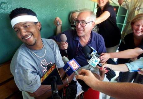 Injured Pedro Martinez was in good spirits as he held court with the media unexpectedly in the dugout after finishing his throwing in the outfield during batting practice on Aug. 2, 2001.