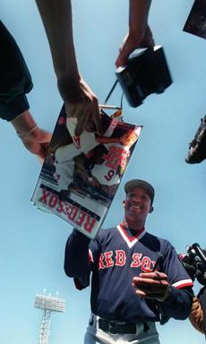 Pedro Martinez is mobbed by fans as he signs autographs prior to a sunny Sunday afternoon game against the Mariners on April 12, 1998.