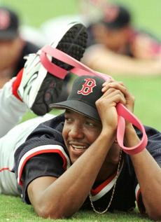 Pedro Martinez enjoys his first day in spring training on Feb. 16, 1998, as he and the rest of the pitchers and catchers stretch.