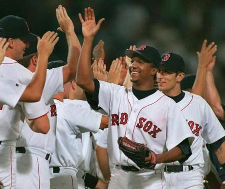 Pedro Martinez is in the middle of the postgame high-fives after his masterful four-hit complete game shutout of the Indians gave the Red Sox a 1-0 victory on July 15, 1998.