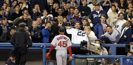 Pedro Martinez leaves the field at Yankee Stadium in the eighth inning of Game 7 of the 2003 ALCS after giving up five runs.