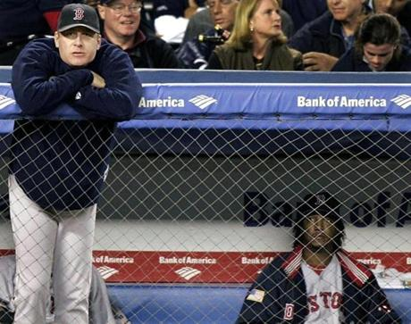 Curt Schilling (left) and Pedro Martinez (right) in the Boston dugout as the visitors trail the Yankees in Game 2 of the ALCS on Oct. 13, 2004.