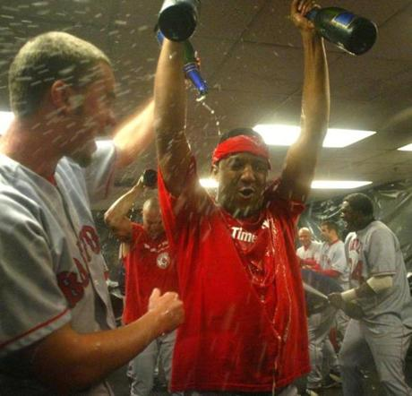 Pedro Martinez gets a champagne bath in a raucous locker room after the AL Division clincher on Oct. 6, 2003, in Oakland, Calif.