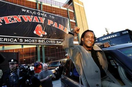 Pedro Martinez heads out of Fenway Park on Oct. 29, 2004, after an early morning flight from St. Louis, where the Red Sox would go on to win the World Series.