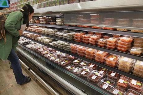 Cambridge, MA 043014 Banshan section includes ready to go vegetables and other foods at H Mart in Cambridge, Wednesday, April 30 2014. (Wendy Maeda/Globe Staff) section: Lifestyle slug: 14shhmart reporter: Debra Samuels