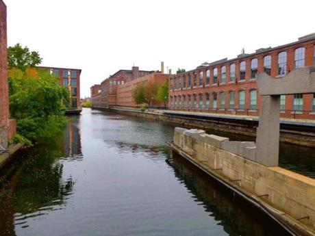 The old canals and red brick mills still form a central part of Lowell's cityscape.