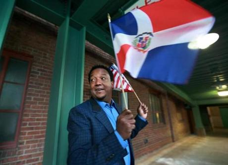 Former Red Sox pitcher Pedro Martinez waves both American and Dominican flags as he arrives at Fenway Park for a late afternoon press conference on the day he was elected today to the Baseball Hall of Fame, January 6, 2015.