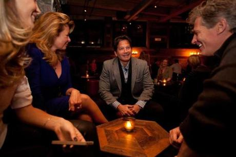 1/16/15 Boston, MA -- Photos of Seth Greenberg (center) at Bastille Kitchen in Boston, January 16, 2015. At left is Gail Huff, right is Scott Brown. Erik Jacobs for the Boston Globe