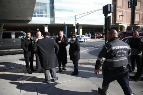 Boston Police detectives gathered outside the Shapiro building.