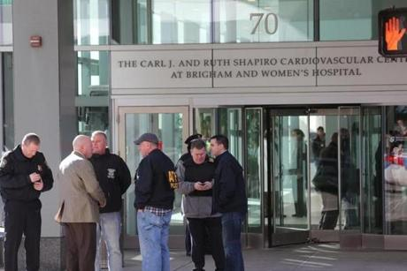 Officials gathered outside the Carl J. and Ruth Shapiro Cardiovascular Center after the shooting Tuesday.