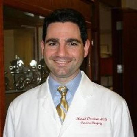 Dr. Michael Davidson, a cardiovascular surgeon at the hospital and assistant professor at Harvard Medical School, was shot twice and seriously wounded.