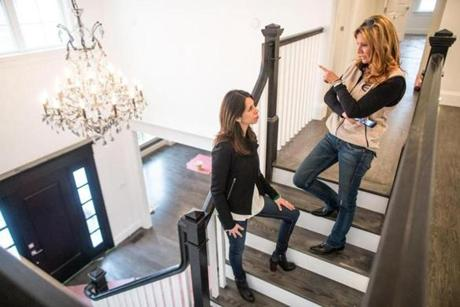 01/06/2015 NEWTON, MA Homeowner Alexandra Almonacid (cq) (left) discusses renovations with contractor Cindy Stumpo (cq) at the Almonacid family home on Upland Street (cq) in Newton. (Aram Boghosian for The Boston Globe)