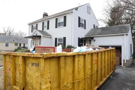 Belmont Ma 01/22/2015 A large dumpster sits in front of a Belmont home that is undergoing renovations. Home Renovations projects are keeping contracting companies busy. Globe Staff/Photographer Jonathan Wiggs Topic: Reporter