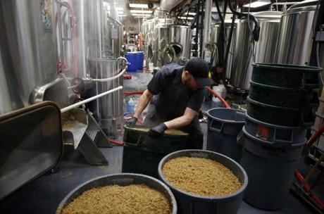 Lead brewer Jim Conroy, 40, of Waterbury, Vt., moved a barrel of mash at the Alchemist brewery, where Heady Topper is made, then sold quickly nearby.