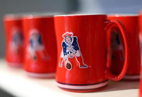 Foxborough-01/24/15-The Patriots Pro shop has been a popular place as fans can buy just about anything Patriots related. Coffee mugs. Boston Globe staff photo by John Tlumacki (lifestyle)