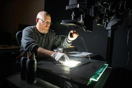 Imaging technician Bruce Myren works with a Sinar 54H to digitize photos for the BPL.