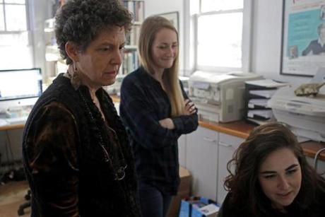 Laurie Kahn (left) looked at pictures with production assistant Riley Davis (center) and production coordinator Julia Hines.