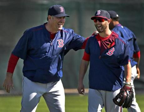 Red Sox manager John Farrell (left) acknowledged that the club wants to decrease's Dustin Pedroia's workload.