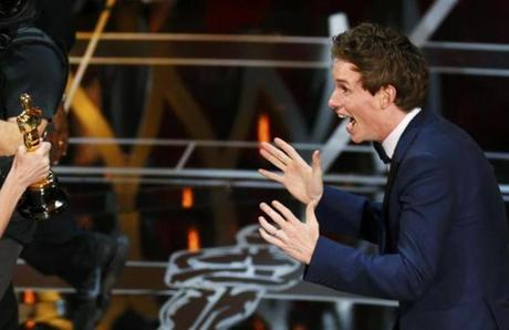 Eddie Redmayne reacted as he took the stage to accept the Oscar for best actor for his role in