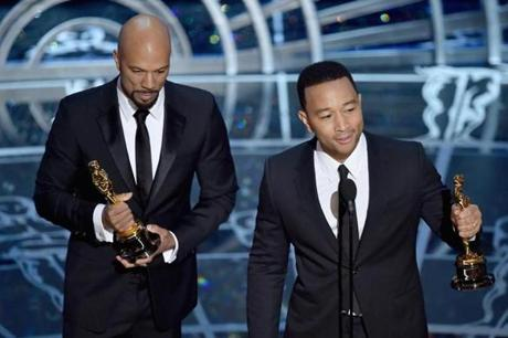 Common (left) and John Legend acepted the best song award for their song