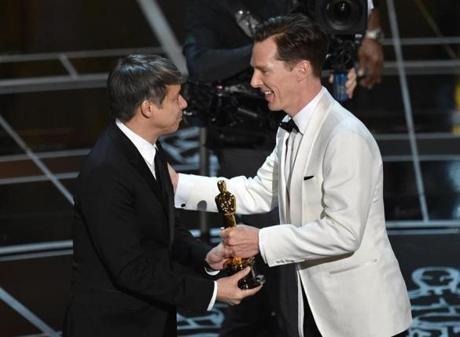 Benedict Cumberbatch (right) presented Tom Cross with the award for best film editing for